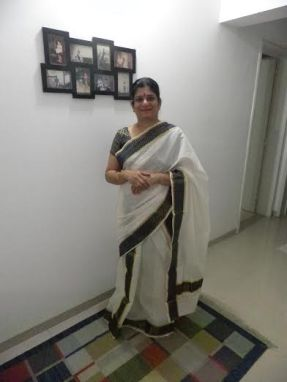 Asha draped in her  traditional Mundu