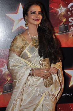 Rekha carrying her Signature Clutch